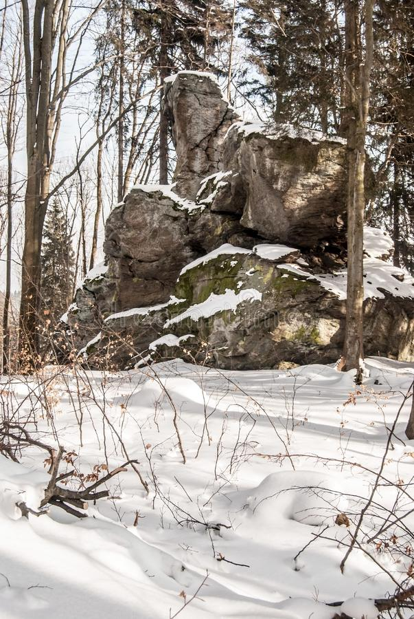 Rock formation in winter Jeseniky mountains in Czech republic. Rock formation in winter Jeseniky mountains above Vrbno pod Pradedem in Czech republic with snow royalty free stock images