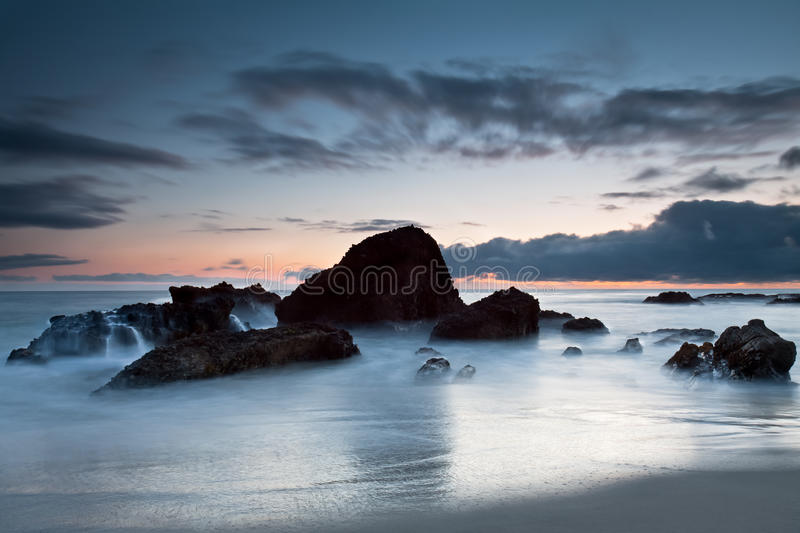 Rock formation at Woods Cove, Laguna Beach, Califo. A seascape of sea rock formation with a dramatic sky. This image was taken at Woods Cove, Laguna Beach in royalty free stock photo