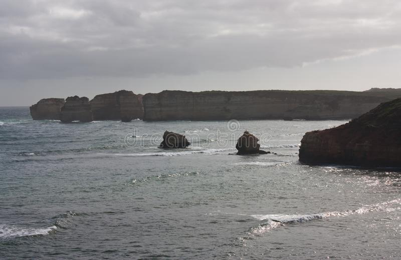 Rock formations in the Bay of Islands on the Great Ocean Road in Australia stock images