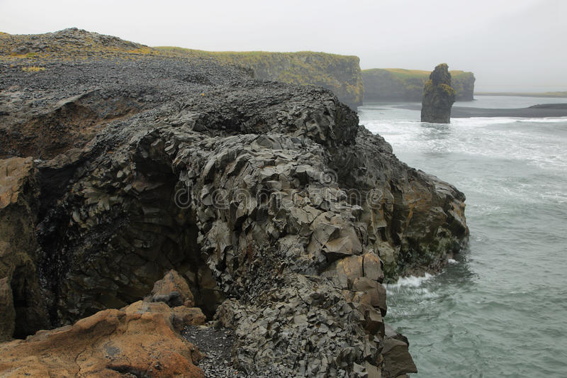 Rock formations in Cape Dyrholaey. Beautiful rock formation o Cape Dyrholaey, the most southern point of Iceland royalty free stock photography