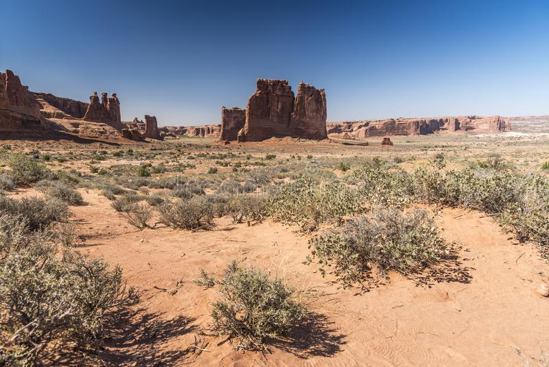Rock formations and desert brush, Arches National Park Moab Utah stock photography