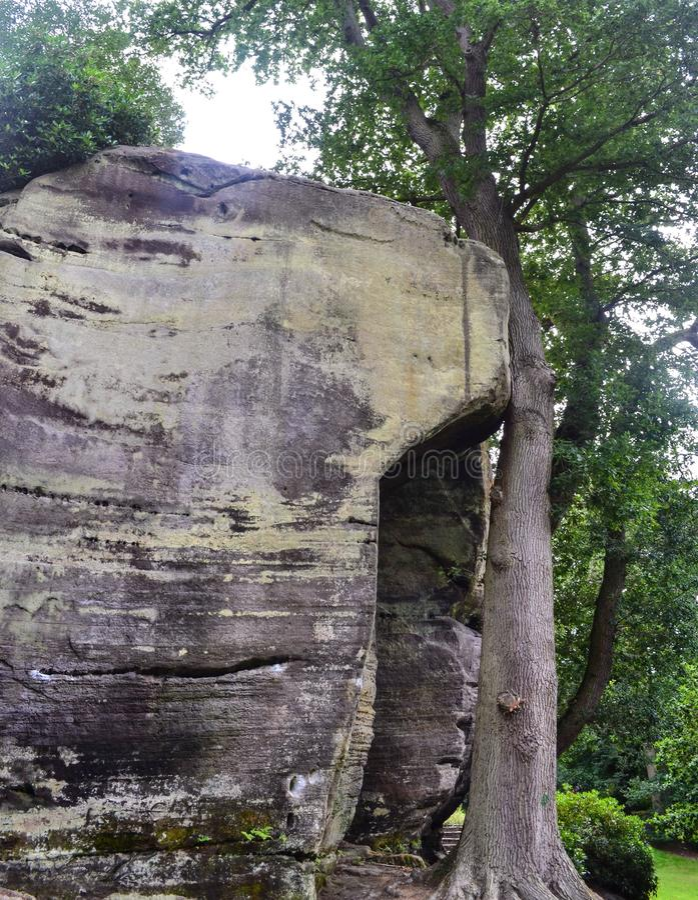 Rock formations at High Rocks, Tunbridge Wells, Kent, UK. Rock formations at the ancient `High Rocks` park in Tunbridge Wells, Kent, showing fractured and stock photography