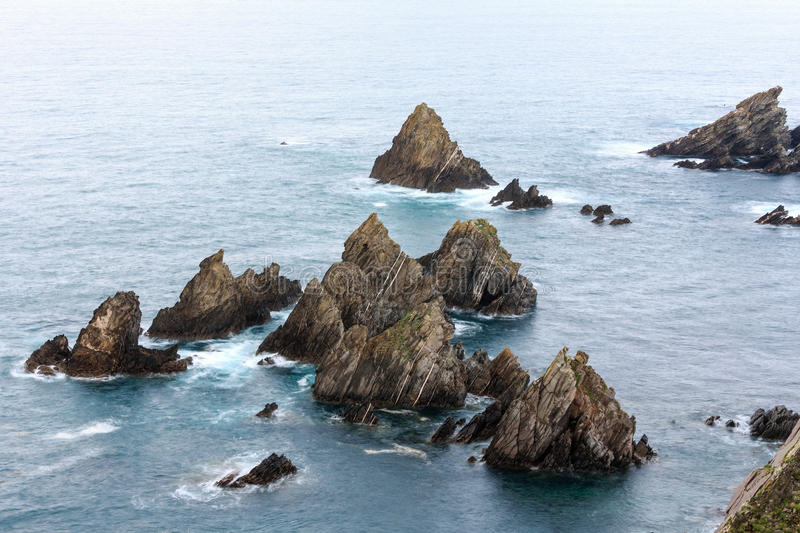 Rock formations near shore. stock photo