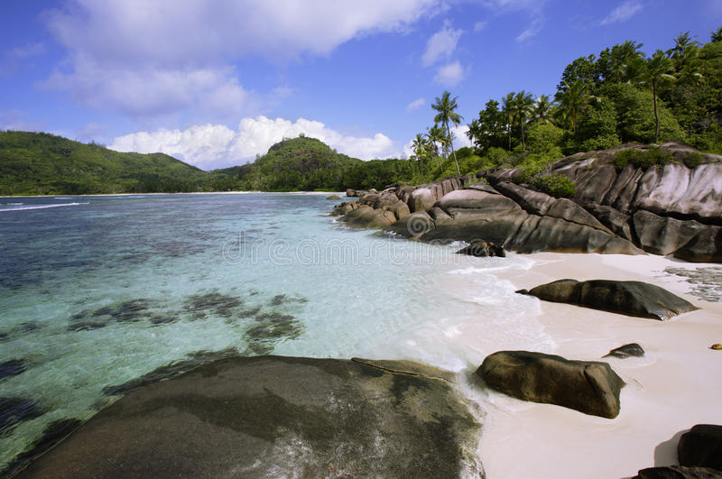 Rock formations in surf, Baie Lazare, Mahe`, Seychelles stock photo
