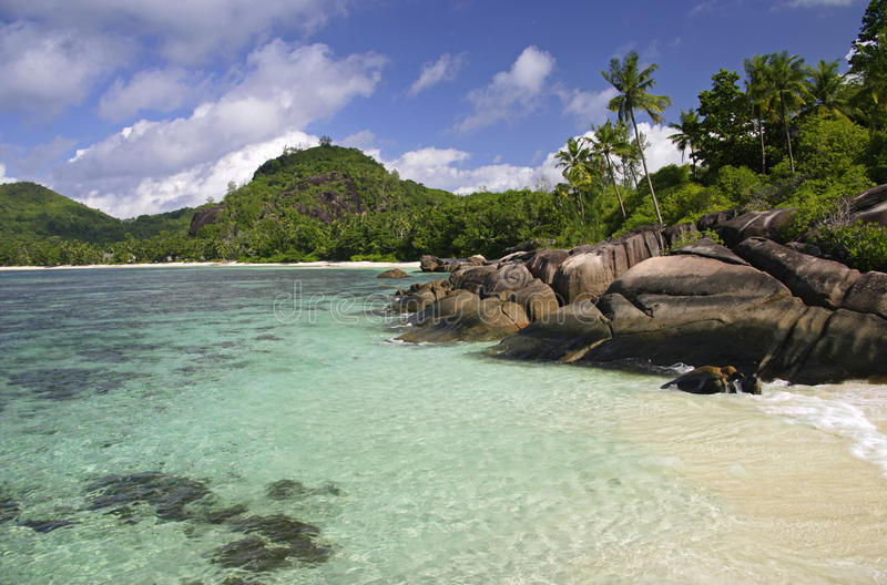 Rock formations in surf, Baie Lazare, Mahe`, Seychelles stock photos