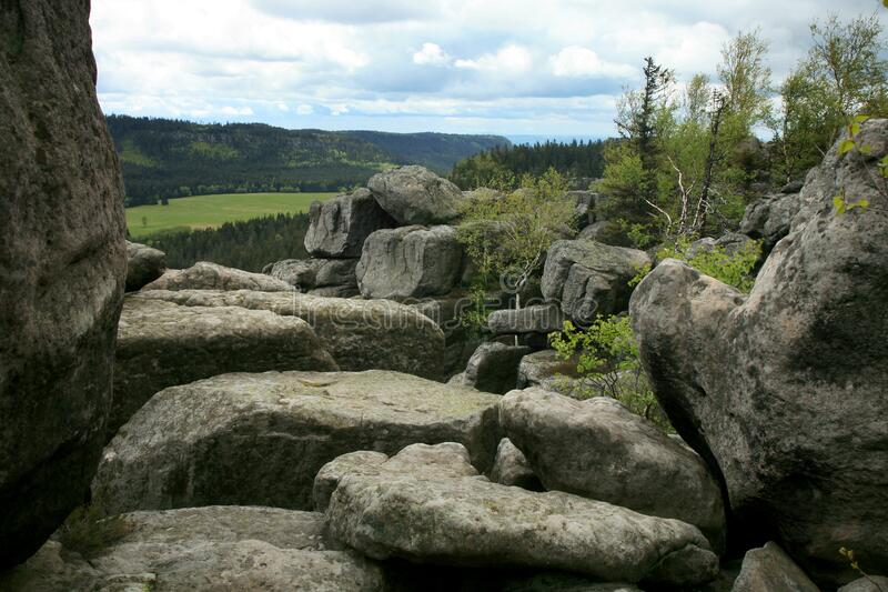 Rock formations in Szczeliniec Wielki in the Stolowe Mountains, the Sudeten range in Poland. stock photography