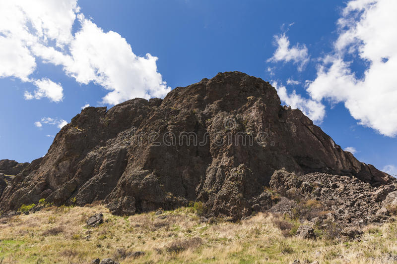 Rock Formations Under Blue Sky. Rock formations under partly-cloudy blue sky at Tower Rock State Park in Montana, USA royalty free stock image