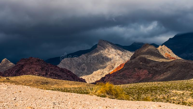 Dramatic sky with colourful mountains royalty free stock photos