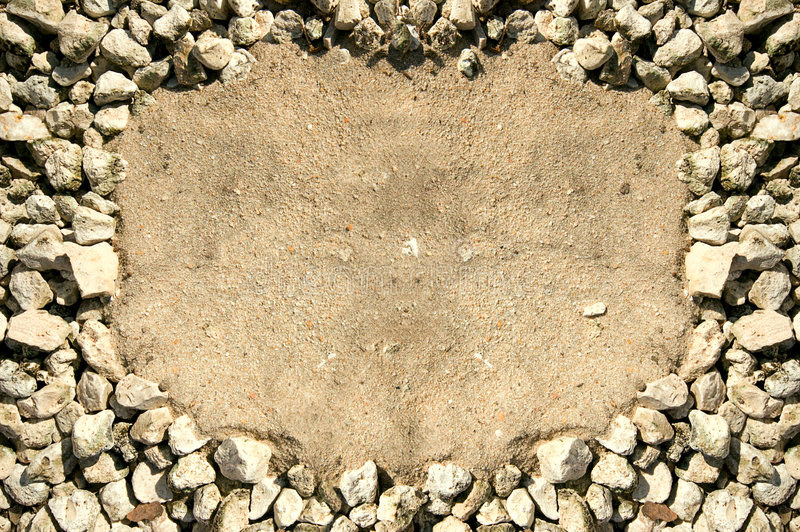 Rock frame. Rocks surrounding a sandy area to create a frame and area to add your own copy stock images