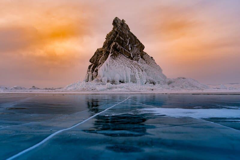 Rock on freeze water lake, Baikal Russia winter season stock photo