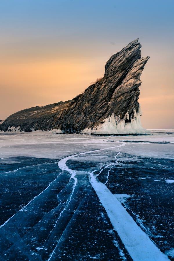 Rock on frozen winter water lake Siberian Baikal Russia stock photo