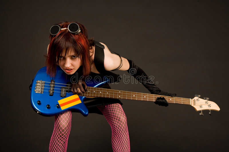 Download Rock girl with bass guitar stock image. Image of goggles - 5275527