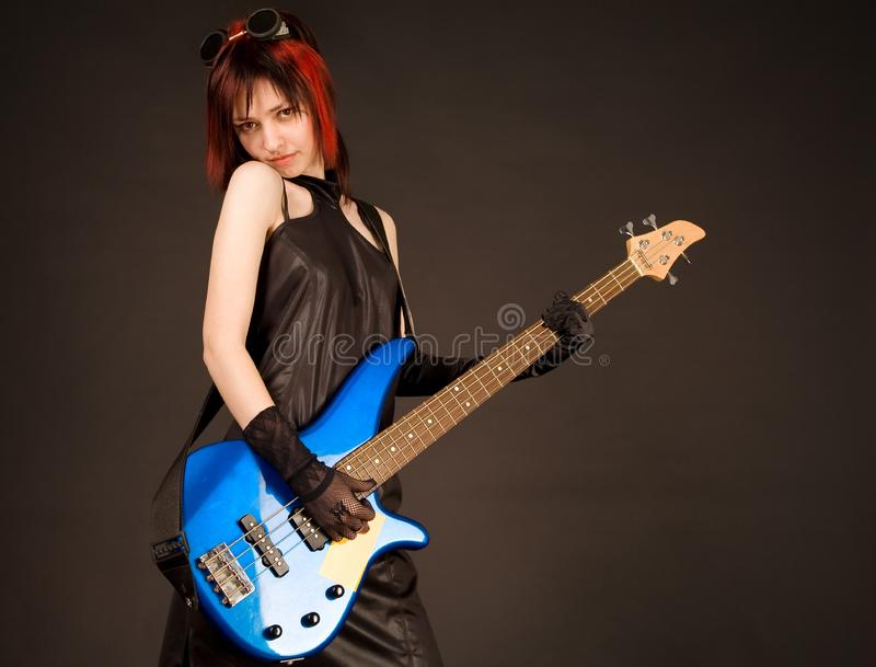 Rock girl with blue bass guitar royalty free stock photos