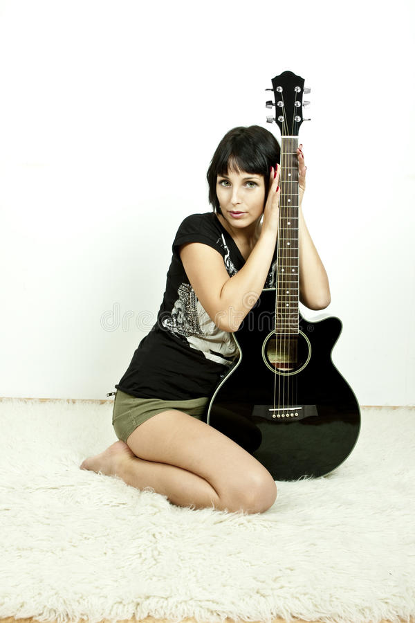 Rock Girl With Guitar Stock Images