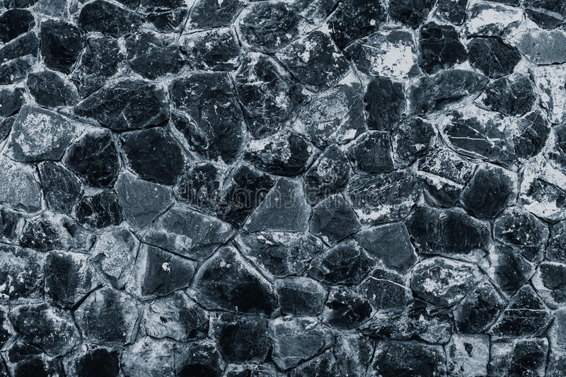 Rock granite stone solid wall strong stock image
