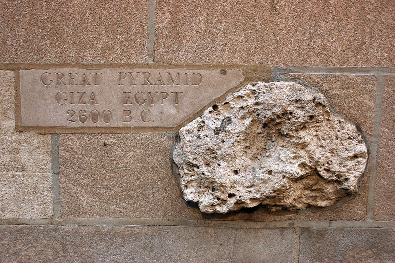 A rock from the Great Pyramid, embedded in a wall in Chicago stock photography