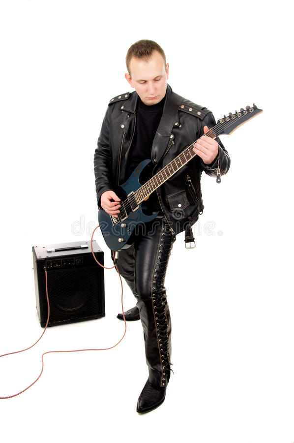 Rock guitarist in leather garments, plays guitar. Isolated on white background royalty free stock image