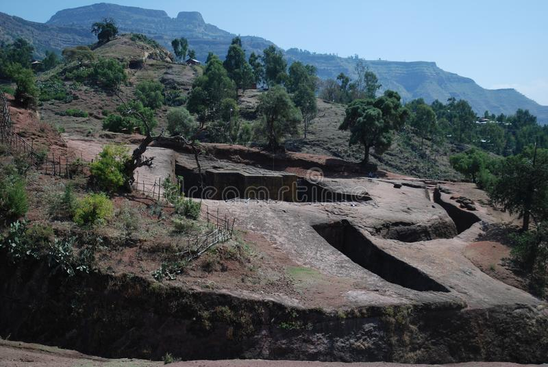 Rock hewn church of Bet Giyorgis, Saint George, from the distance, Lalibela, Wollo, Ethiopia. Rock hewn church of Bet Giyorgis, Saint George, patron Saint of royalty free stock photo