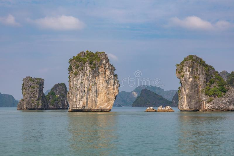 Rock islands near floating village in Halong Bay, Vietnam, Southeast Asia.  royalty free stock photography