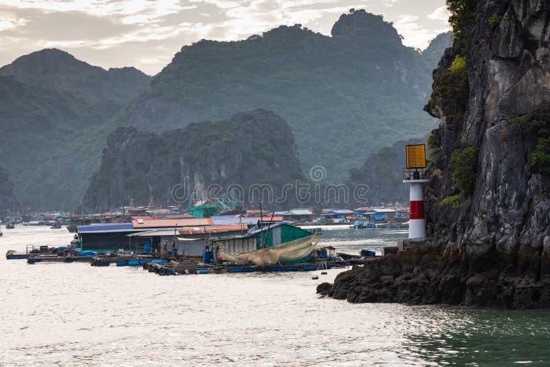 Rock islands near floating village in Halong Bay, Vietnam, Southeast Asia.  royalty free stock photo
