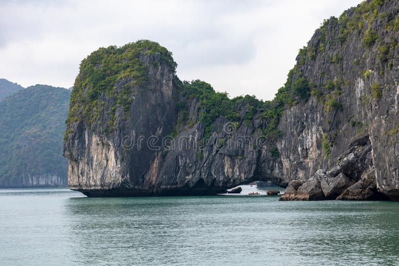 Rock islands near floating village in Halong Bay, Vietnam, Southeast Asia.  stock photography