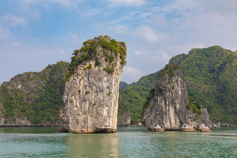 Rock islands near floating village in Halong Bay, Vietnam, Southeast Asia.  stock images
