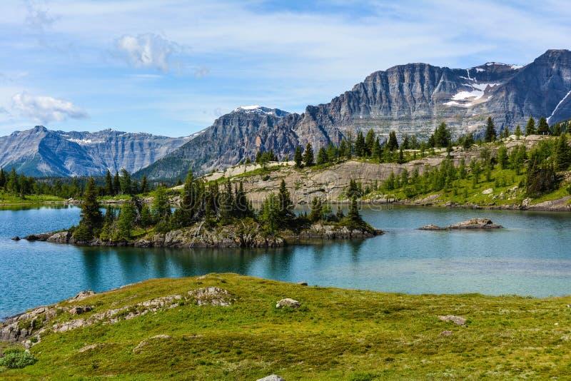 Rock Isle lake. Mountains background royalty free stock photography