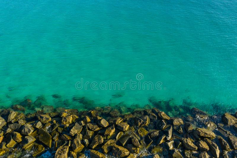 Rock jetty and water. USA stock image