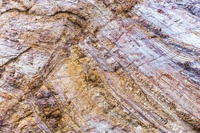 Rock layers colorful background with fascinating texture. stock photography