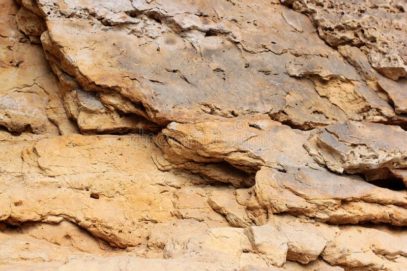 Rock layers - a colorful formations of rocks stacked over the hundreds of years. Interesting background with fascinating texture.  royalty free stock images