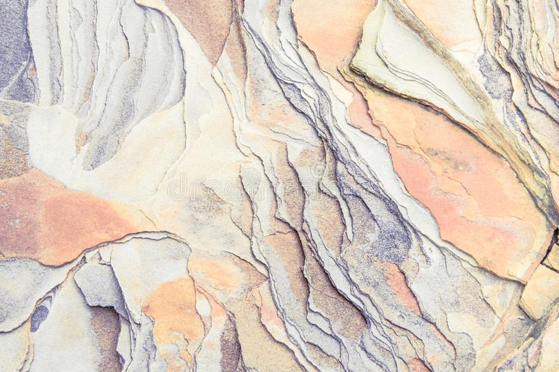 Rock layers - a colorful formations of rocks stacked over the hundreds of years. Interesting background with fascinating texture. And pattern stock photos