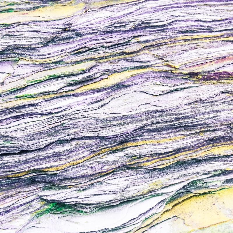 Rock layers - a colorful formations of rocks stacked over the hundreds of years. Interesting background with fascinating texture. And pattern royalty free stock photo