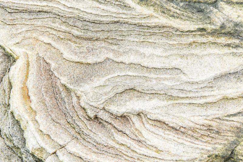 Rock layers - a colorful formations of rocks stacked over the hundreds of years. Interesting background with fascinating texture. And pattern stock photo