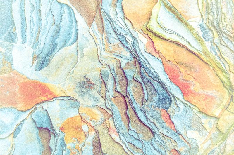 Rock layers - a colorful formations of rocks stacked over the hundreds of years. Interesting background with fascinating texture. And pattern royalty free stock image