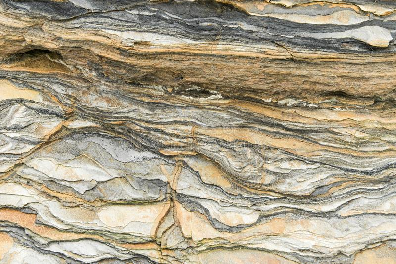 Rock layers - a colorful formations of rocks stacked over the hundreds of years. Interesting background with fascinating texture. And pattern stock photography