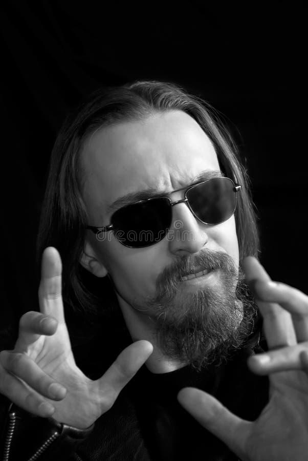 Rock man in sunglasses royalty free stock photos