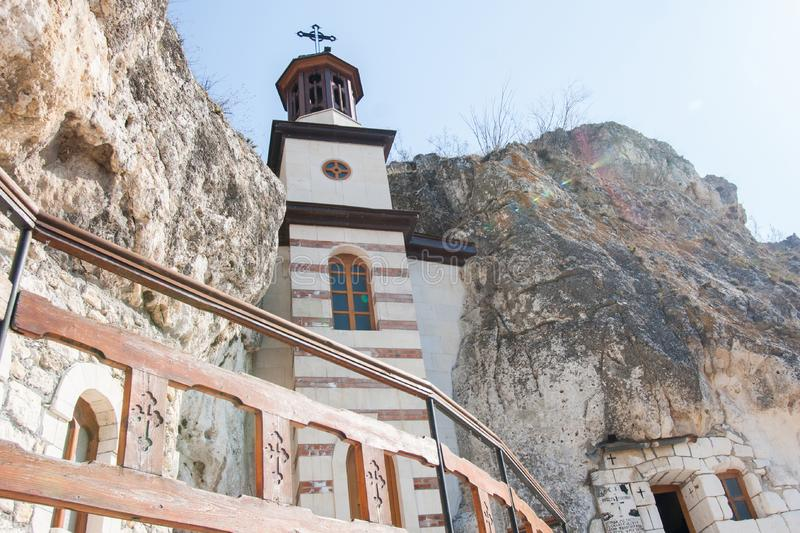 Basarbovo monastery with belltower, Bulgaria. The rock monastery Saint Dimitrii of Basarbovo find it in the picturesque valley of the Rusenski Lom River royalty free stock photos