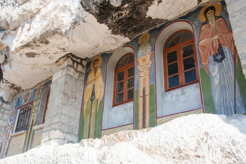 Exterior painted windows of Basarbovo monastery, Bulgaria. The rock monastery Saint Dimitrii of Basarbovo find it in the picturesque valley of the Rusenski Lom stock images