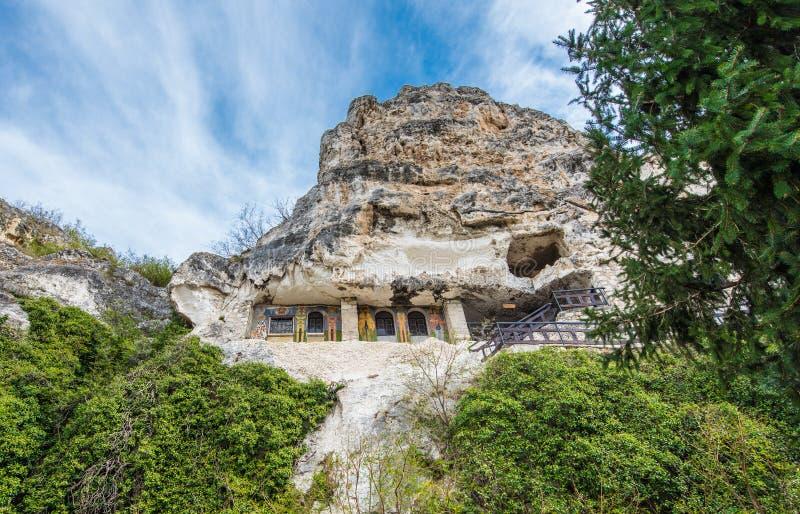 Rock monastery `St. Dimitar Basarbovski` in Basarbovo, Bulgaria royalty free stock photo