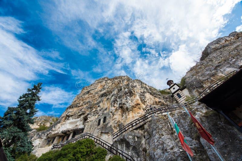 Rock monastery `St. Dimitar Basarbovski` in Basarbovo, Bulgaria royalty free stock image