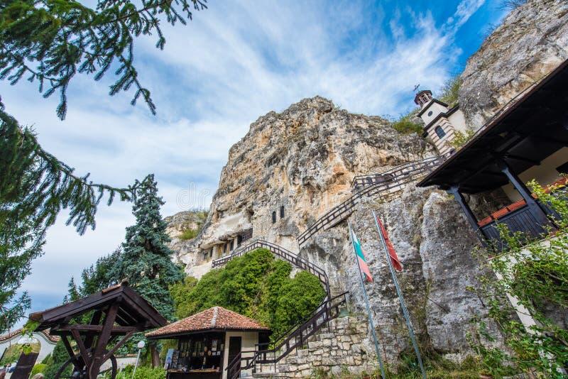 Rock monastery `St. Dimitar Basarbovski` in Basarbovo, Bulgaria stock photo