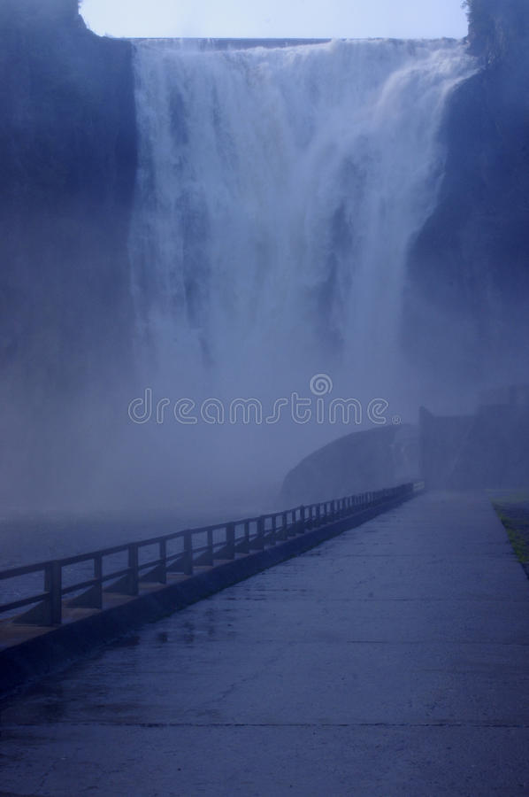Rock mountain at Montmorency Falls. Montmorency Falls waterfall in mist royalty free stock photography