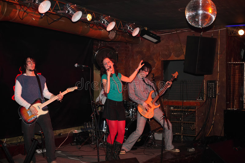 Rock music band on stage. Indoor royalty free stock photo