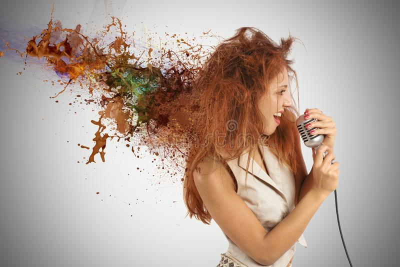 Rock music. Concept of rock music with girl singer with motion effect stock image