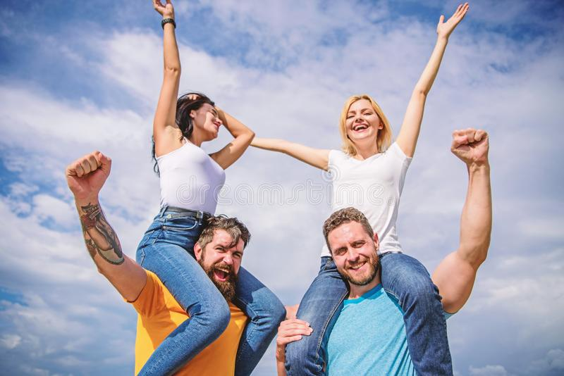 Rock music festival. Feel freedom. Cheerful couples dancing. Friends having fun summer open air festival. Men and women. Enjoy music festival. Visit famous royalty free stock images