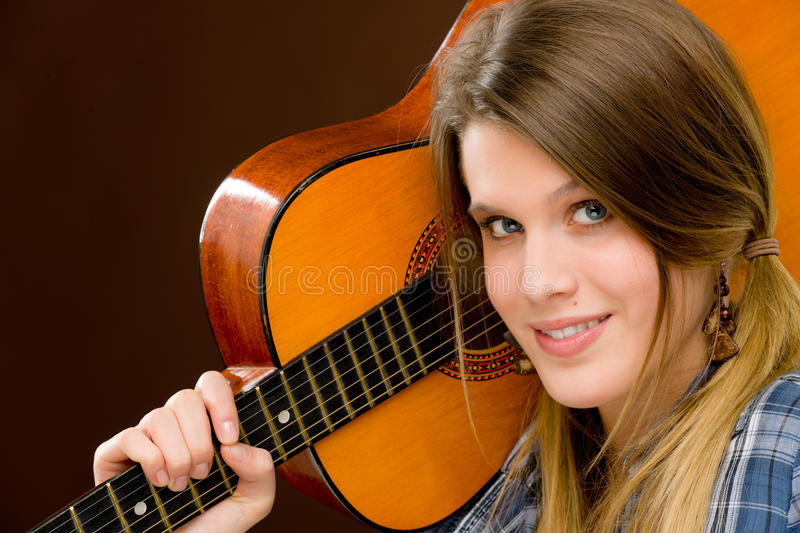Rock musician - fashion woman holding guitar royalty free stock photography