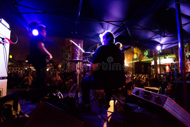 Rock musicians on stage playing stock photography