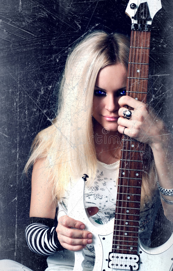 Download Rock-n-roll With The Beautiful Blonde Stock Photo - Image: 7775868