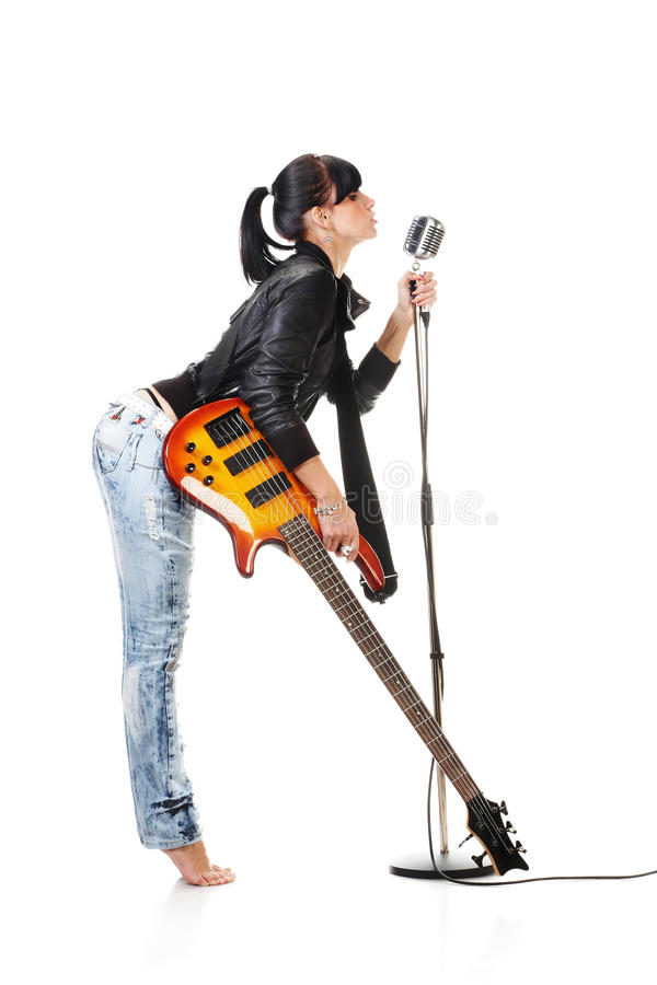 Free Rock-n-roll Girl Holding A Guitar Singing Into Ret Royalty Free Stock Image - 10990486