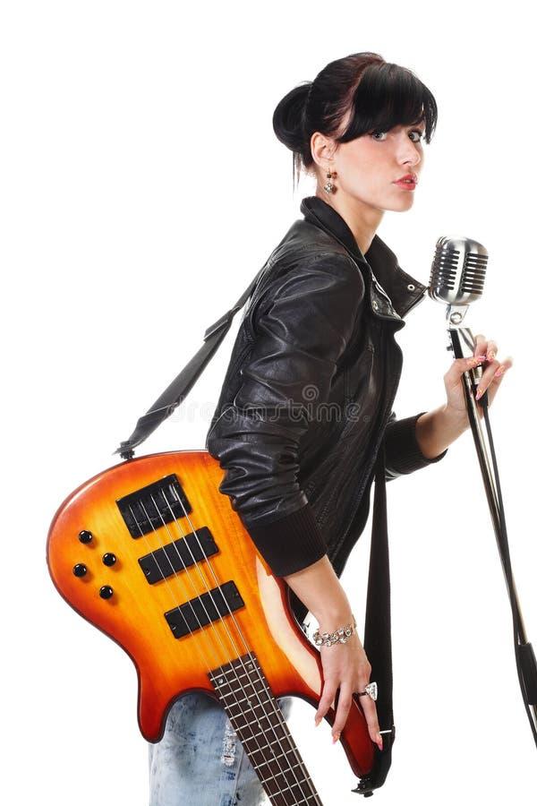 Rock-n-roll girl holding a guitar stock photos